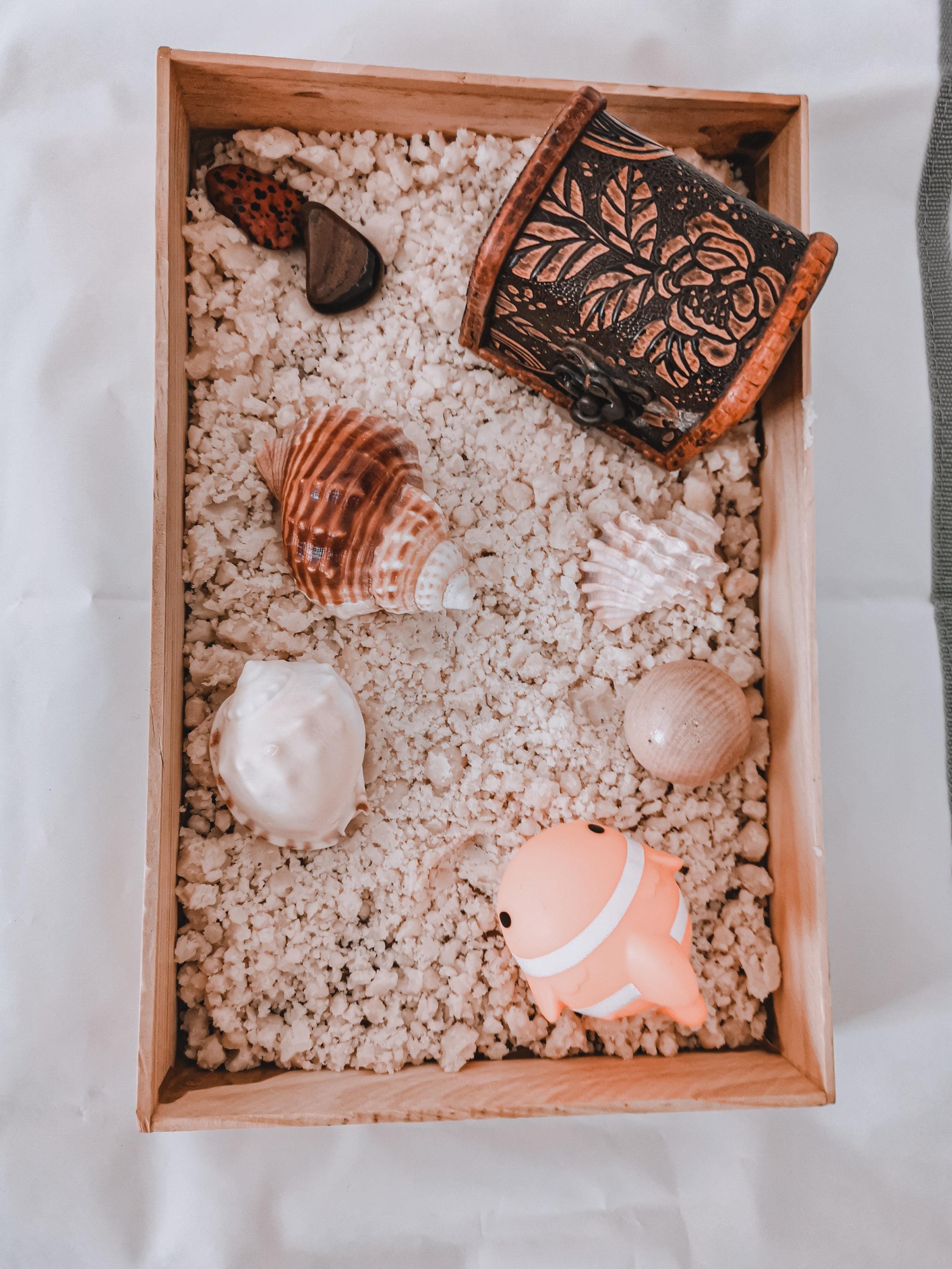 Diy beach sand sensory bin